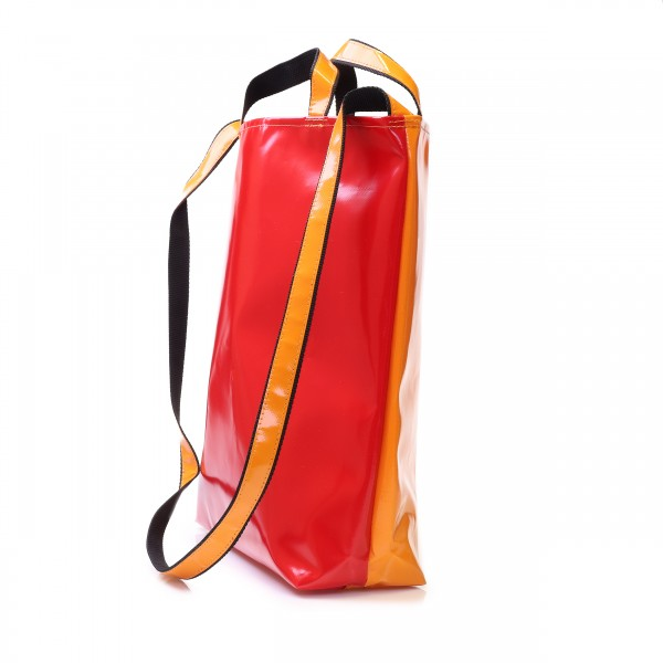 Shopping bag made of red and orange truck tarpaulin with hand and shoulder strap