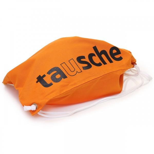 Turnbeutel Rucksack aus orangefarbiger Baumwolle mit tausche-Aufdruck