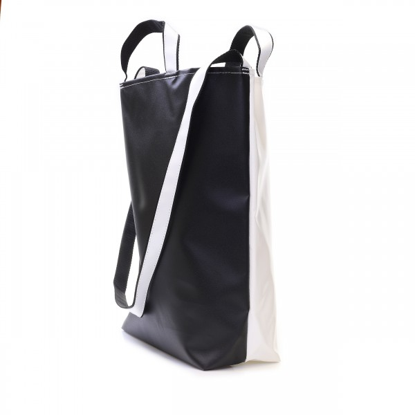 Shopper made of white and black truck tarpaulin with handles and shoulder strap