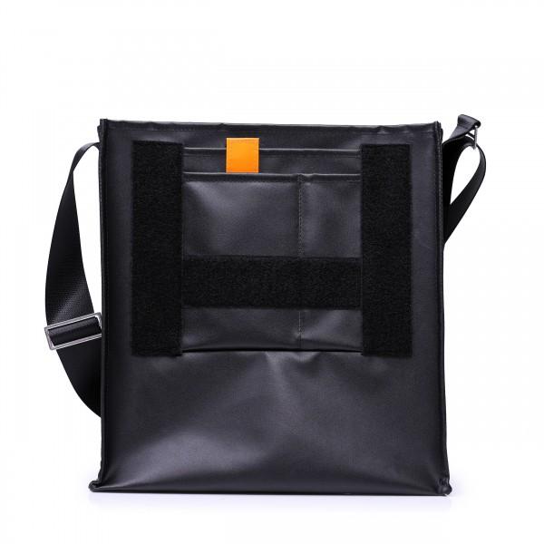 Shoulder bag made of black matt truck tarpaulin in portrait format