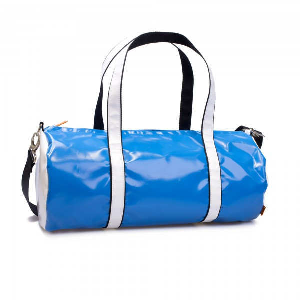 Sports bag made of blue tarpaulin with white contrasting sides and handles